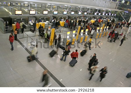 passengers queuing up for check-in - stock photo