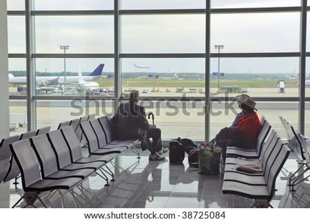 Passengers waiting at the airport. - stock photo