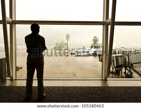 Passengers waiting to board the aircraft. - stock photo