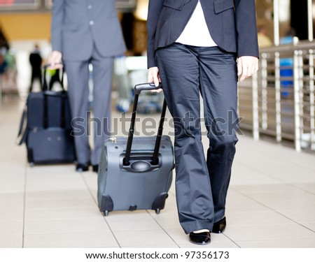 passengers walking in airport with luggages - stock photo