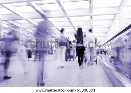 Passengers walking in the airport channel - stock photo