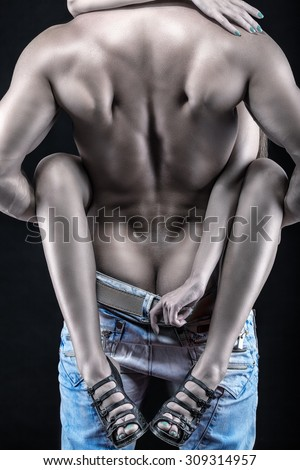 Passion couple on a black background - stock photo