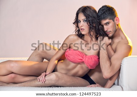 Passion couple on couch - stock photo