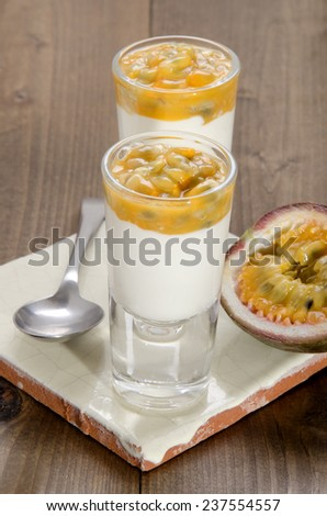 passion fruit and organic yogurt in a shot glass - stock photo
