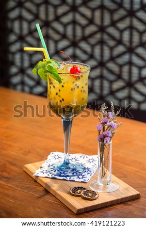 Passion fruit juice on a wooden table - stock photo