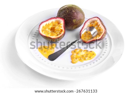 Passion fruit on plate isolated on white - stock photo