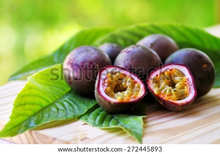 Passion fruits on wooden table - stock photo
