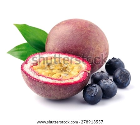 Passion fruits with blueberries close up on white. - stock photo