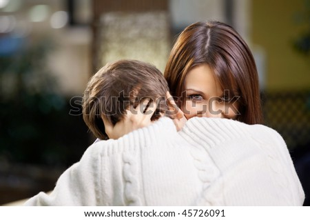 Passionate and joyful embraces of a loving couple - stock photo