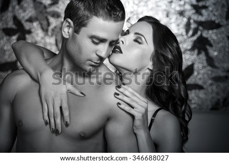 Passionate couple foreplay at night, black and white, bdsm - stock photo