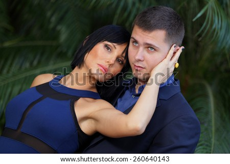 Passionate couple in blue - stock photo