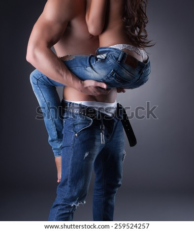 Passionate embrace of sexy models in jeans - stock photo