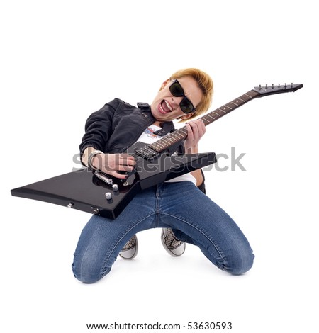 passionate rock girl playing an electric guitar on her knees - stock photo