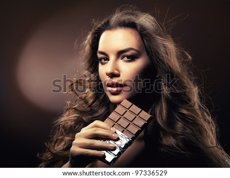 passionate woman with chocolate - stock photo