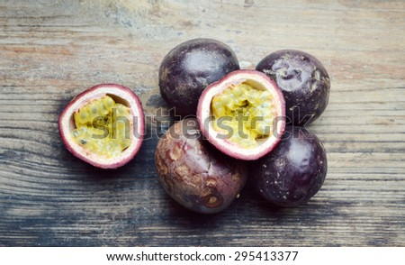 Passionfruit on a wooden table - stock photo