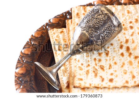 passover background. traditional plate, wine cup and matzoh isolated - stock photo