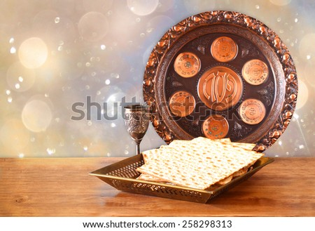 passover background. wine and matzoh (jewish holiday bread) on wooden board - stock photo