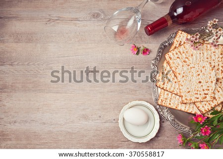 Passover background with matzah, seder plate and wine. View from above - stock photo