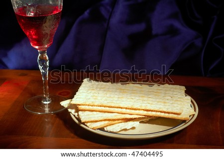 Passover elements of matzoh crackers and wine - stock photo