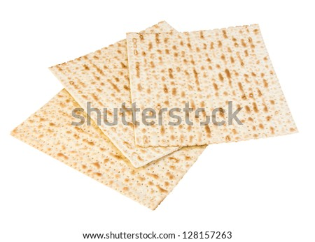 Passover food of faith, matzo. Three square matzos for the Pesach seder overlapping each other, isolated on a white background. - stock photo