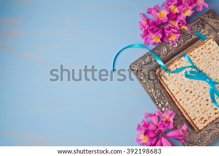 Passover spring holiday background with matzoh and flowers. View from above - stock photo