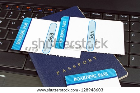 passport and boarding cards on a computer - stock photo