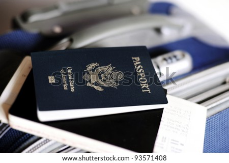 Passport and tickets on a valise - stock photo