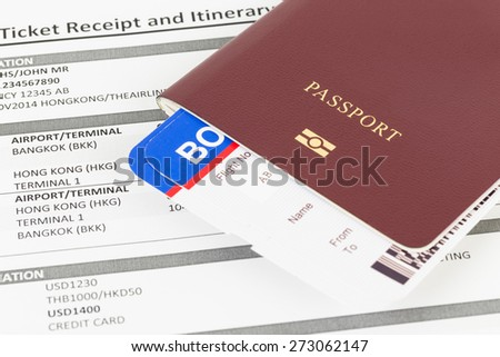 Passport and travel document; e-ticket and boarding pass, information are mock-up - stock photo
