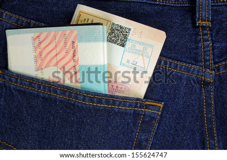 passport and visa in trousers pocket  - stock photo