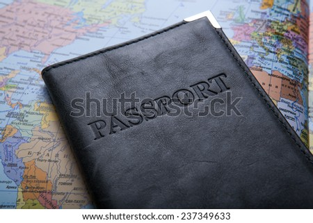 passport in the bag on a map close up - stock photo