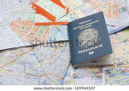 Passport, maps, and tickets on the table - stock photo