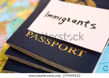 Passport on map. inscription immigrants - stock photo