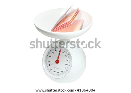 passport on the kitchen scale under the white background - stock photo