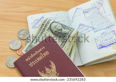 passport stamps dollar bills passport - stock photo