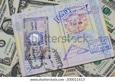 Passport with stamps with us dollar, concept of travel - stock photo