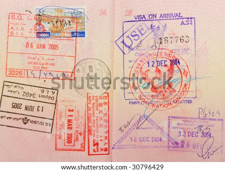 passport with thai and hongkong and lebanese stamps - stock photo