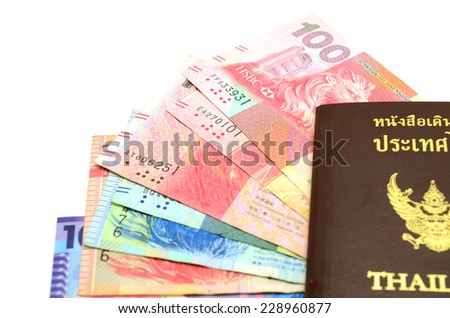 Passport with ticket stubs on top of mixed foreign money including US Hong Kong - stock photo