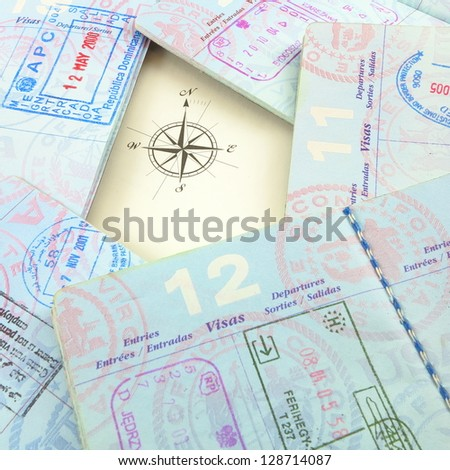 Passports and compass rose - stock photo