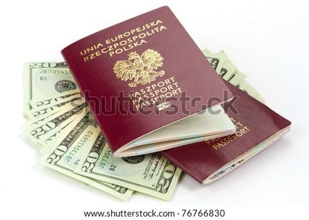Passports and money over white background - stock photo