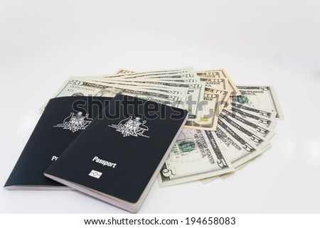 passports and money two of the essentials for international travel - stock photo