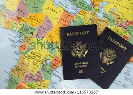 Passports on a map of the world - stock photo