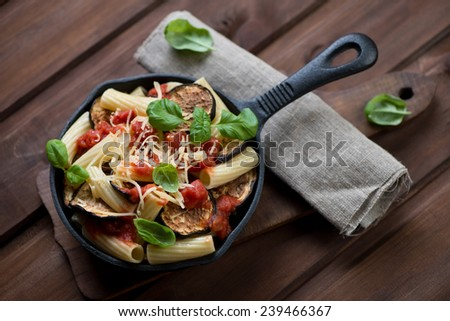 Pasta alla Norma over rustic wooden background, high angle view - stock photo