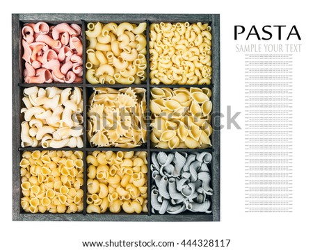 pasta assortment background isolated on white background. Pasta in a wooden box. Italian pasta of different colors. text removed - stock photo