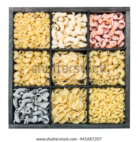 pasta assortment  background isolated on white background. Pasta in a wooden box. Italian pasta of different colors. - stock photo