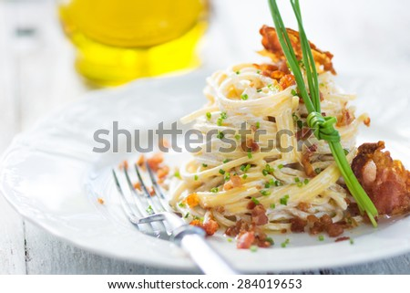 Pasta carbonara with bacon on a plate - stock photo