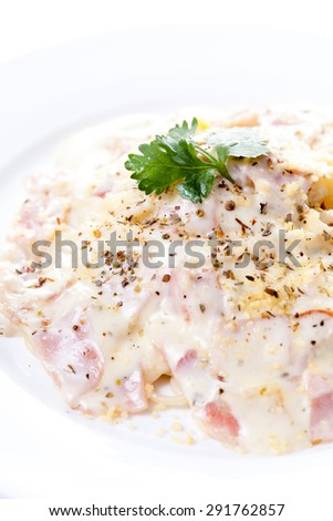 Pasta carbonara with bacon on white background - stock photo