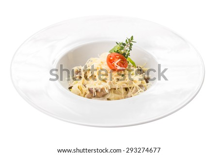 Pasta carbonara with mushroom and sauce isolated on white background. Top view - stock photo