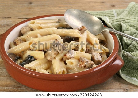 pasta dish with chicken mushroom and grated parmesan in a creamy sauce                                - stock photo