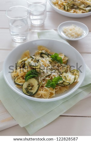 Pasta dish with marinated zucchini. - stock photo
