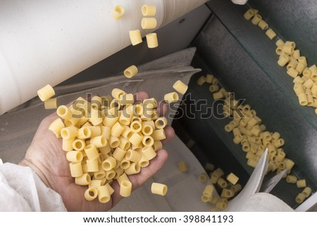 "Pasta factory  La Rustichella d'Abruzzo - ""Ditalini rigati"" (shape) processing - stock photo"